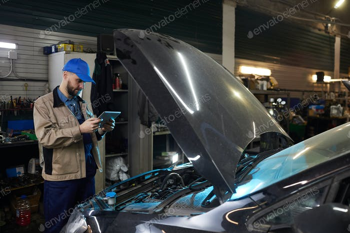 Modern Auto Mechanic With Tablet PC