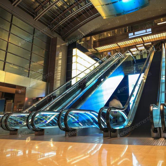 moving escalators in lobby at night