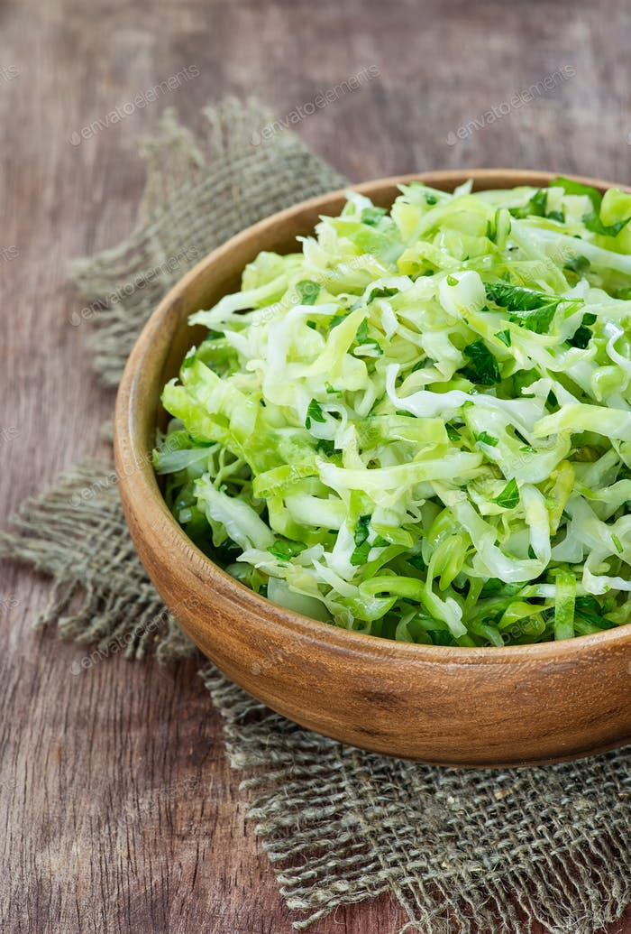 Cabbage salad in wooden bowl