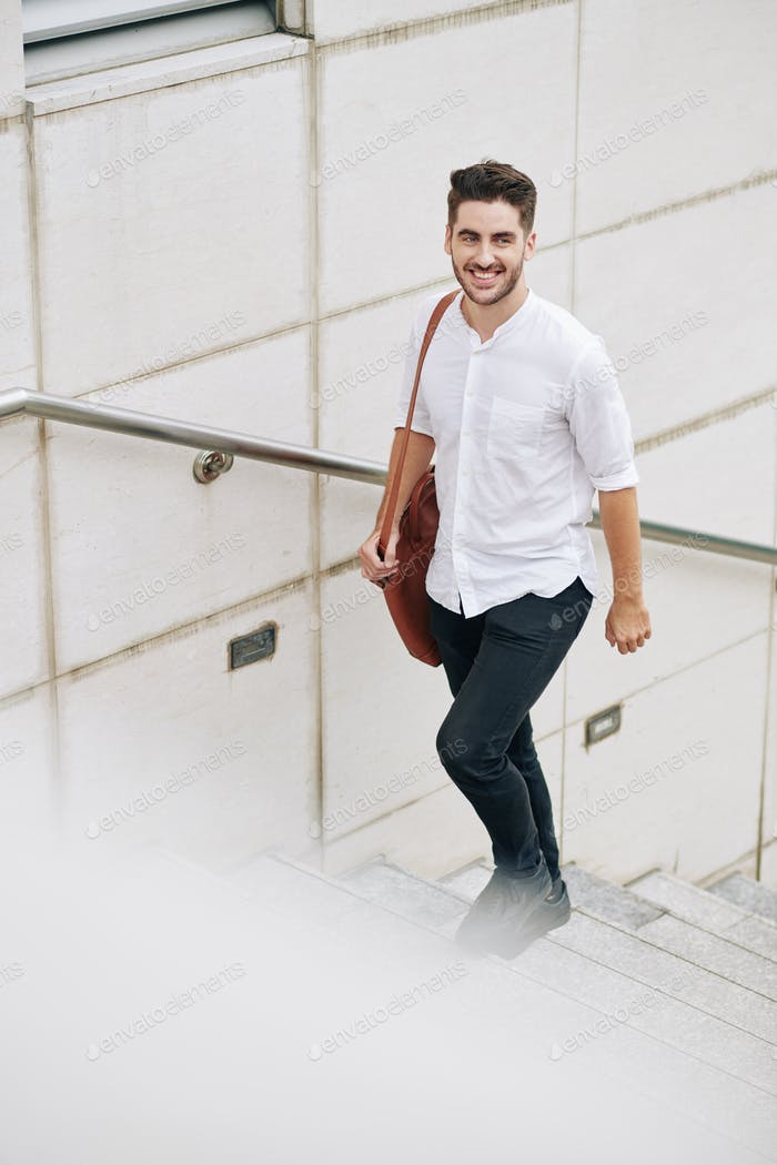 Cheerful man walking up