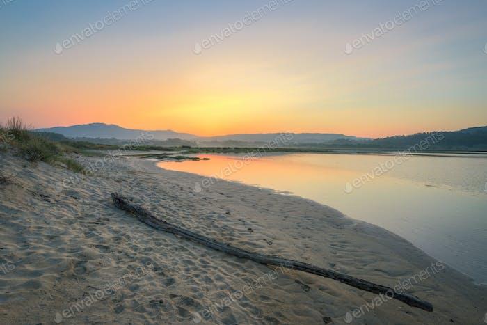 Sunrise over the sandbanks of an estuary