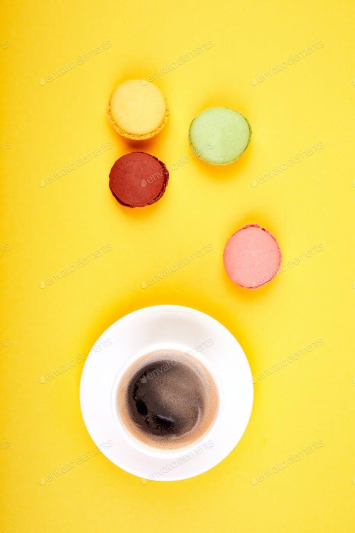 Sweet Dessert Macaron or macaroon with coffee