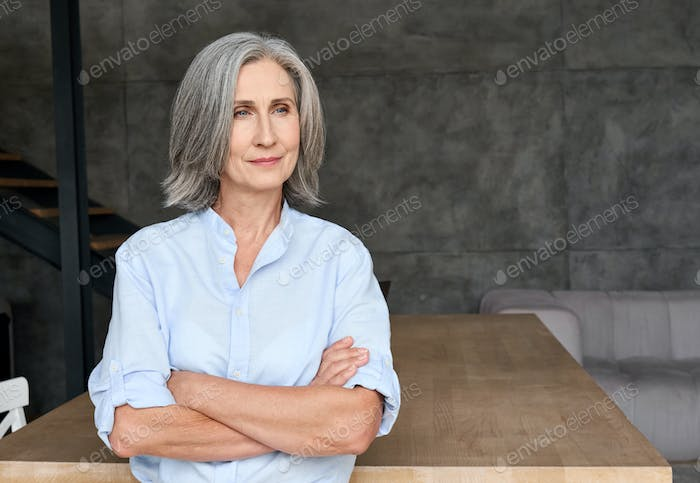 Professional portrait of business woman standing in home office.