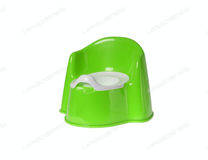 Children's green chamber-pot isolated on white