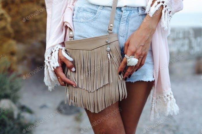 Girl with a small handbag
