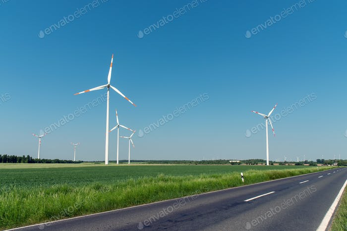 Wind turbines and a country road