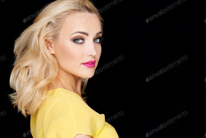 Sexy beautiful blond woman isolated on black