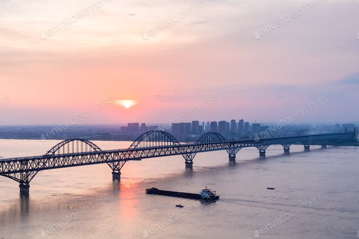 jiujiang yangtze river bridge in sunset