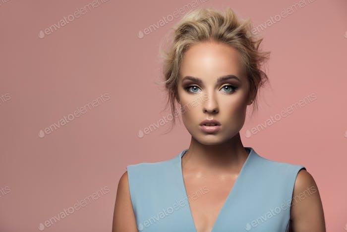 Fashion Portrait Of Beautiful Woman. Rose Background.