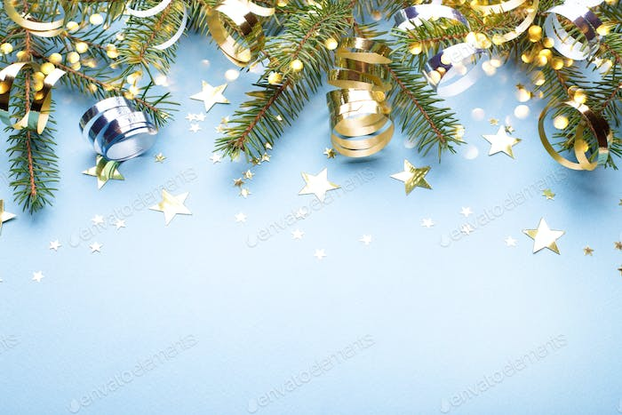 Christmas Background with Fir Branches and Golden Streamers.