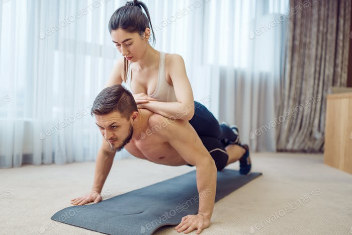 Morning fitness training of love couple at home