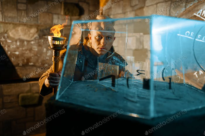 Ancient traveler with torch at the glass puzzle