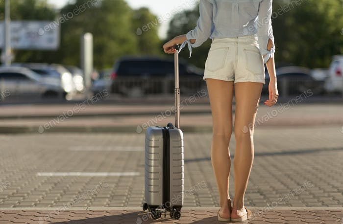 Tourist standing with baggage at airport terminal