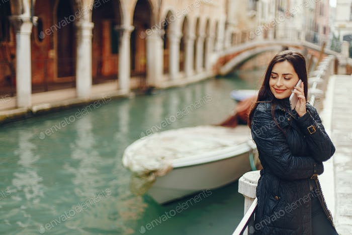 girl talking on the phone and taking pictures in Venice