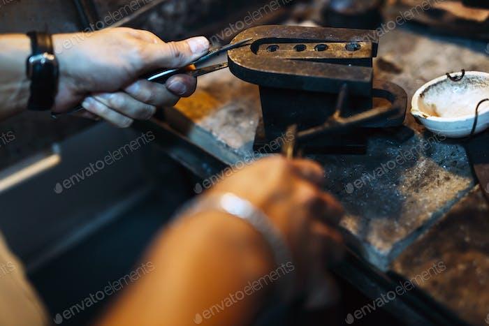 Goldsmith crafting jewels