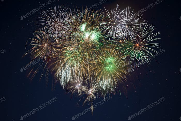Sparkling golden green celebration fireworks