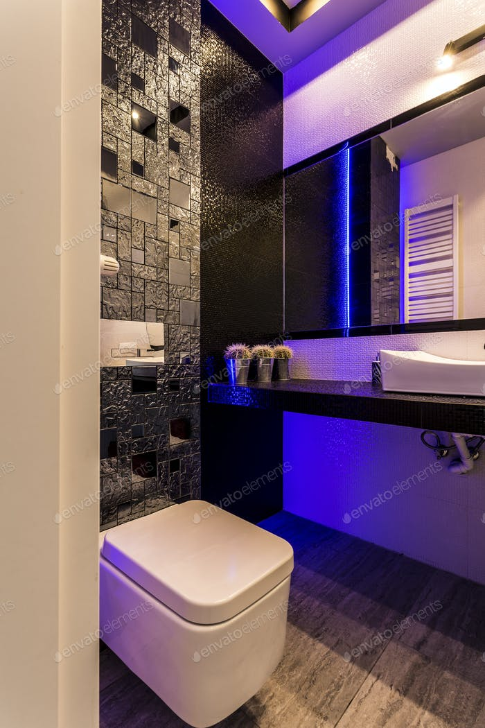 Stylish toilet with dark glossy wall