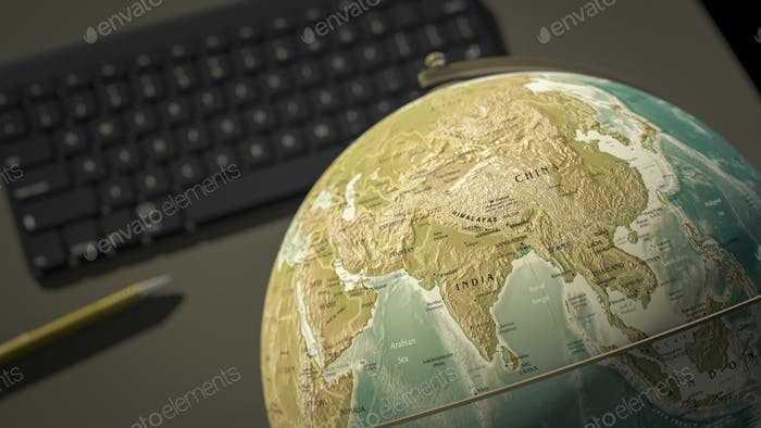 globe on a desktop shows India