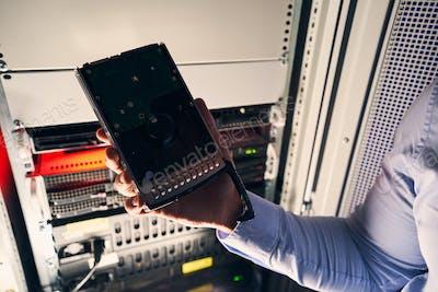 Data center IT technician holding new HDD