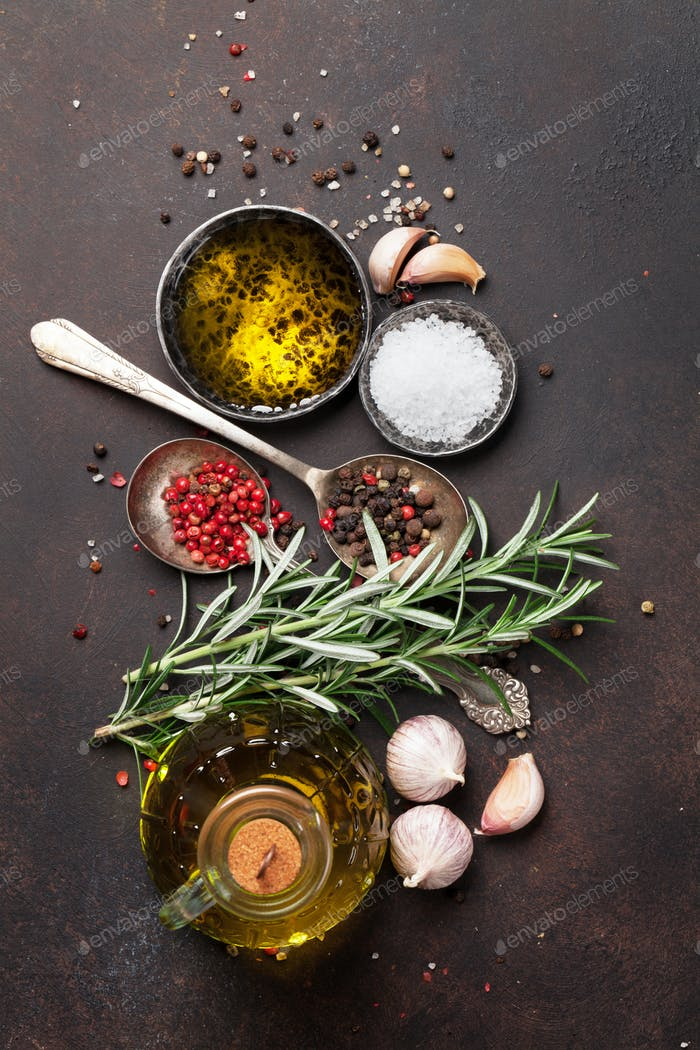 Herbs and spices on stone table