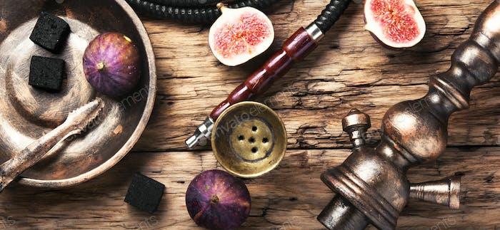 Arabic smoking hookah with figs