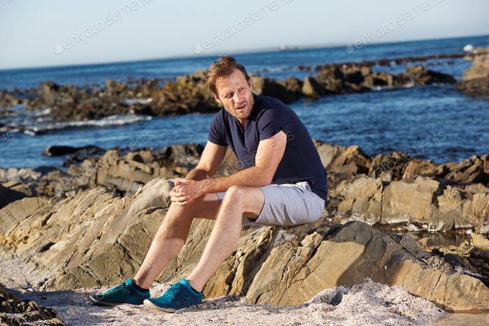 middle age man resting outside after workout