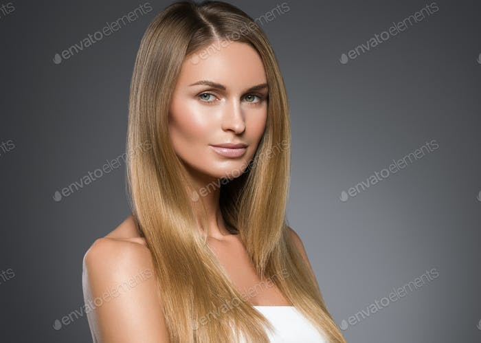 Beauty woman face healthy beautiful skin and blond smooth hair