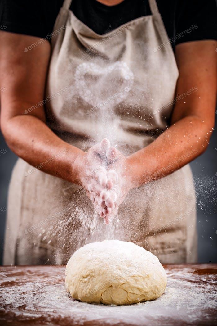 Woman sprinkling flour
