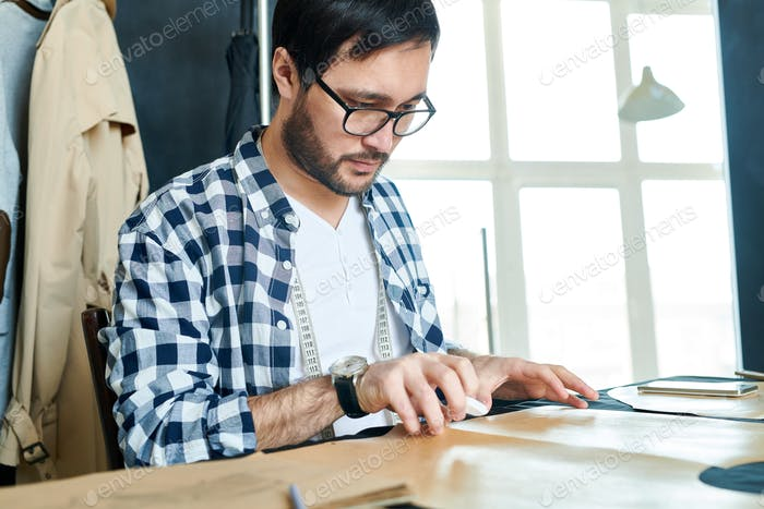 Young designer working with sewing patterns