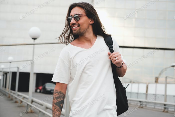 Happy man walking in the city