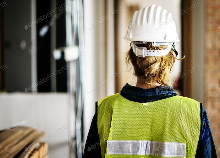 Woman constructor wearing security clothing