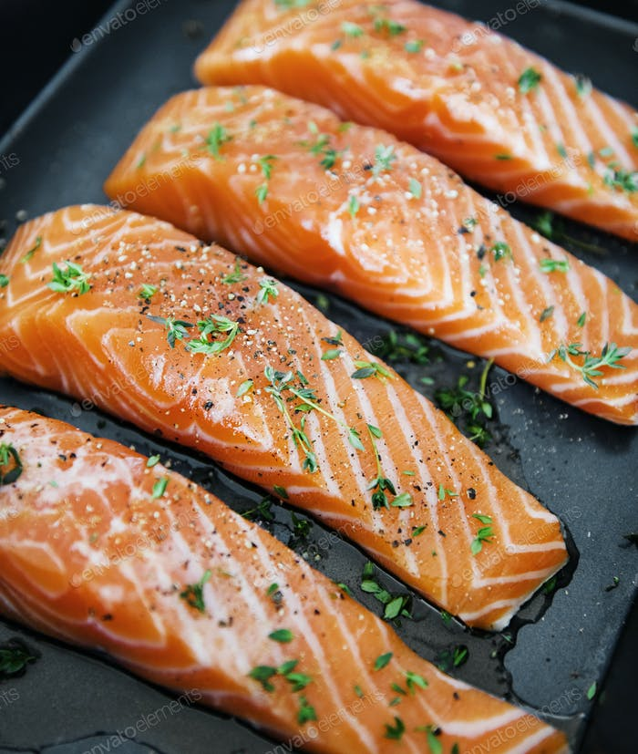 Raw salmon preparing to be cooked