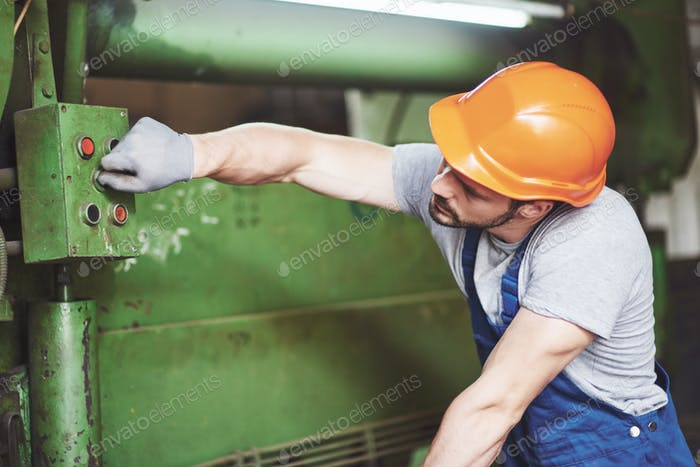 Industrial worker working with lathe in the metalworking industry
