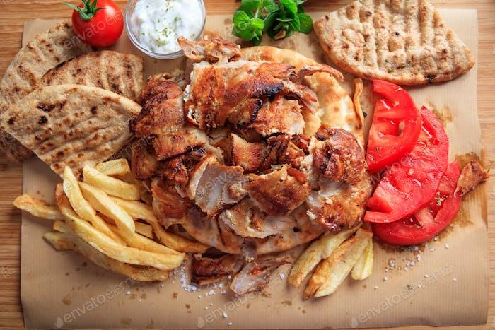 Thumbnail for Greek gyros dish on baking paper - top view