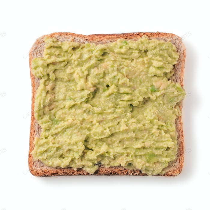 Bread slice with mashed avocado isolated on white