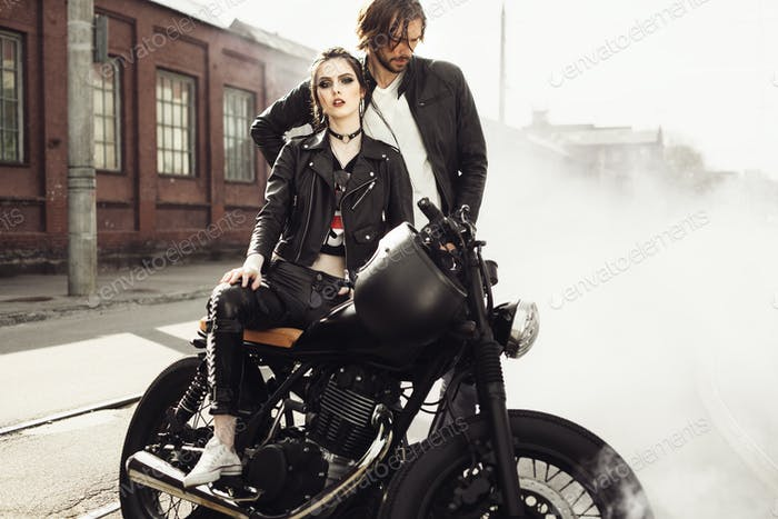 Couple in love and vintage custom motorcycle