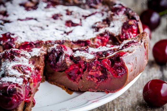 chocolate cake Clafoutis with cherries closeup