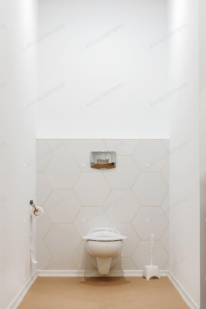 clean white toilet bowl in toilet in modern kindergarten