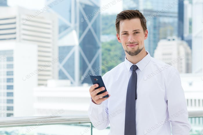 Young businessman use of the smartphone at outdoor