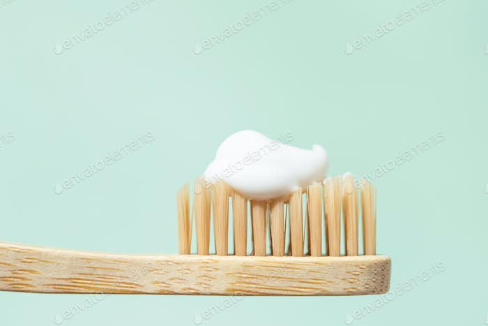 Macro View of Bamboo Toothbrush with Toothpaste.
