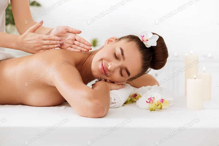 Relaxed girl enjoying massage and aroma therapy