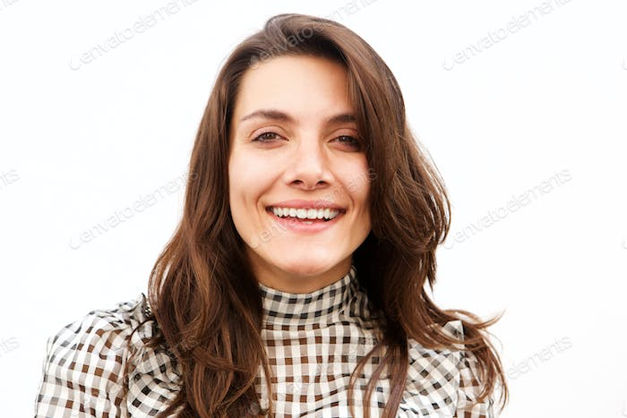Close up happy casual woman standing and smiling by white wall