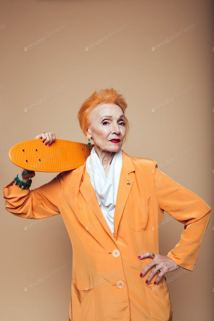 Attractive mature redhead fashion woman