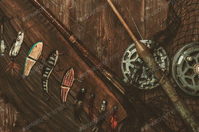 Fishing tools on a wooden background