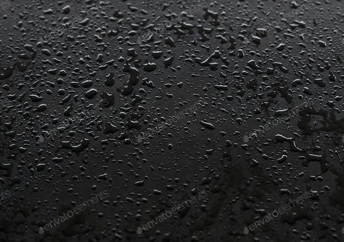 Waterdrops on the black floor