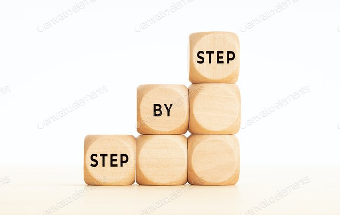 Step by Step phrase on wooden block shape