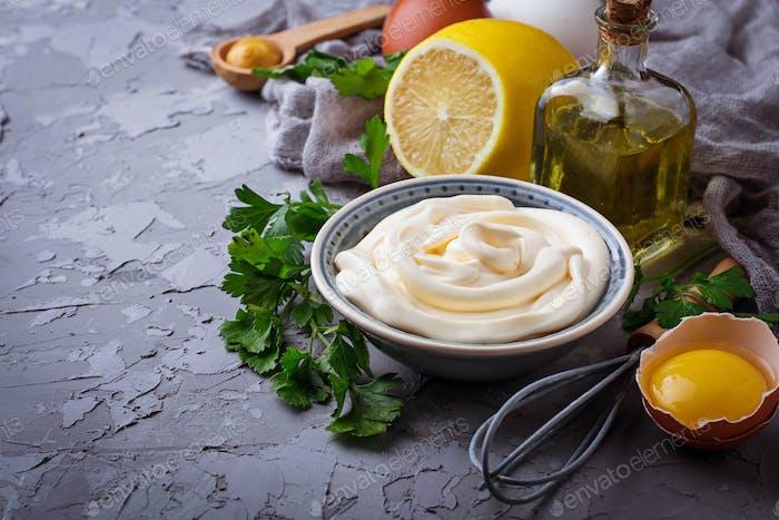Homemade mayonnaise sauce and olive oil, eggs, mustard, lemon