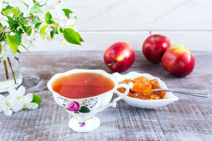 Breakfast tea with fruits and apple confiture.