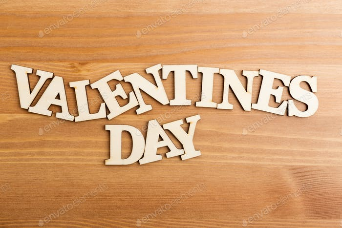 Wooden letters forming phrase Valentines day