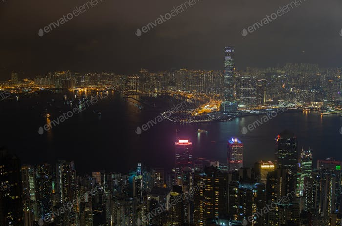 Cityscape famous Hong Kong buildings towers by night harbor